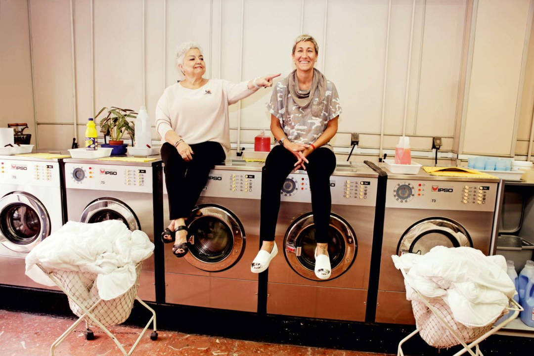 Boundless warmth: Laundromat owner Reyes Huguet (left) with Cristina Falco. ©José Carlos Zarcero